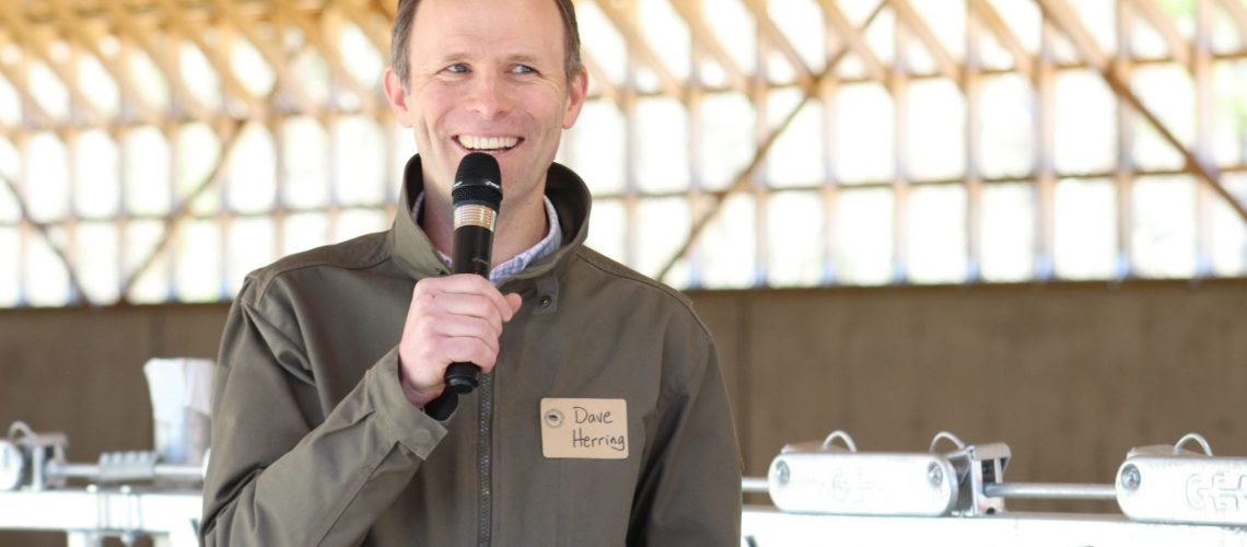 David Herring, executive director of Freeport's Wolfe's Neck Center for Agriculture and the Environment at the grand opening of the farm's new organic dairy facility in May. (Hannah LaClaire/The Times Record)